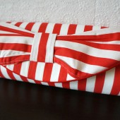 Red striped bow clutch
