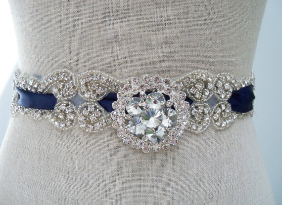 satin blue wedding sash with a brooch