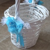 white flower girl basket with turquoise roses