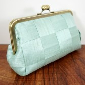 Mint green woven silk clutch