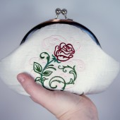 White embroidered rose clutch