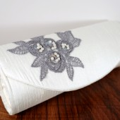 White silk clutch gray applique
