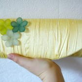 Yellow gathered silk clutch with flower beads