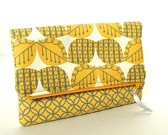 gray and yellow fold over clutch
