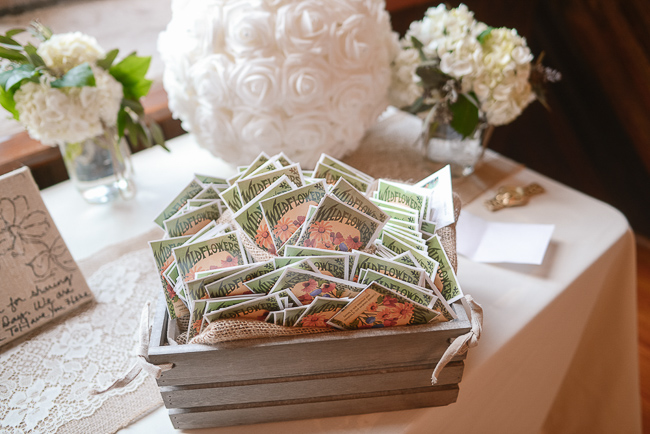 wildseed packets for guests to take home as favors | photo: Photos by Kristopher | via http://emmalinebride.com