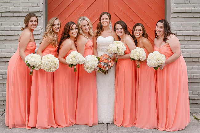 the bridesmaids wore pink strapless chiffon gowns | photo: Photos by Kristopher | via http://emmalinebride.com