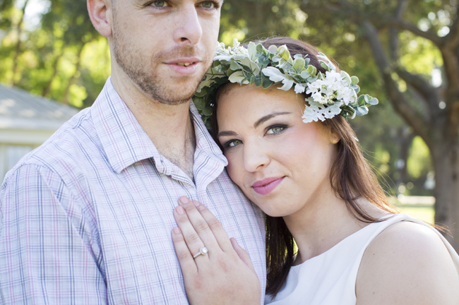 Santa Fe Springs Engagement Session couple embrace and show off engagement ring