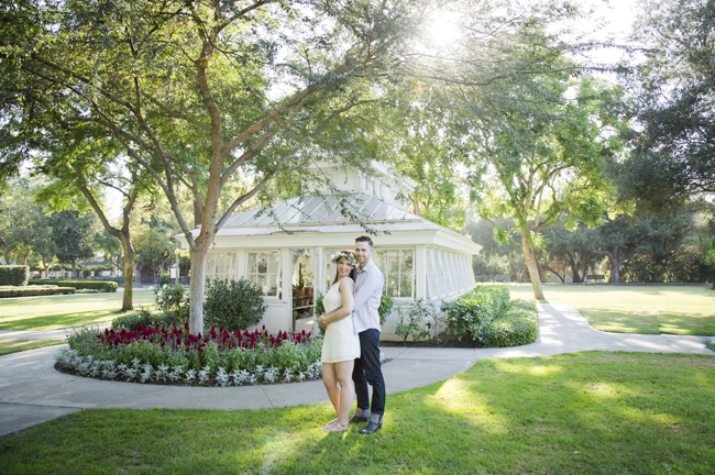 Santa Fe Springs Engagement Session couple stand in front of greenhouse