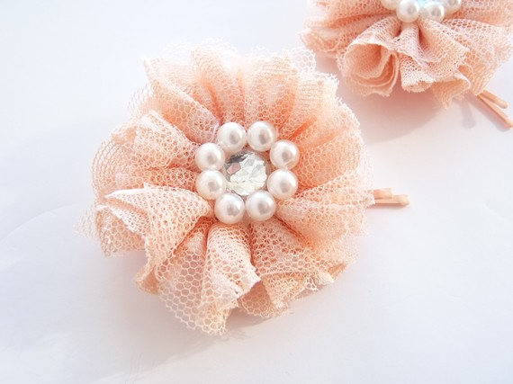 bridal feather headband and matching tulle flower hair pins