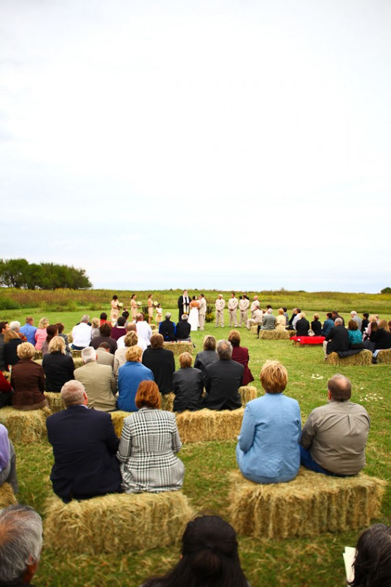 I think the hay bales add to this beautiful ceremony's site and ethereal