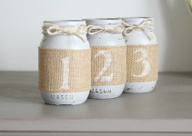 mason jar table numbers wrapped in burlap