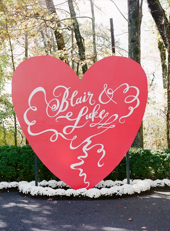 ceremony backdrops - giant red heart with names in calligraphy