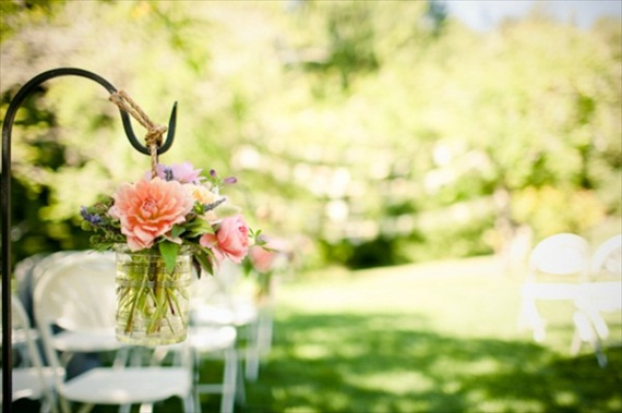 flowers in hanging mason jars for ceremony aisle