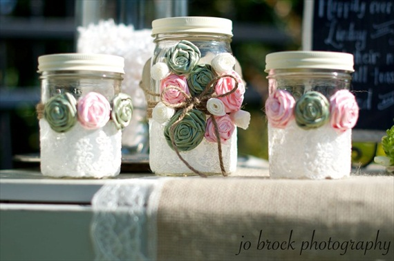 shabby chic wedding mason jar vases with flower rosettes as embellishment