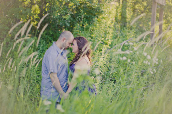 couple kissing woods