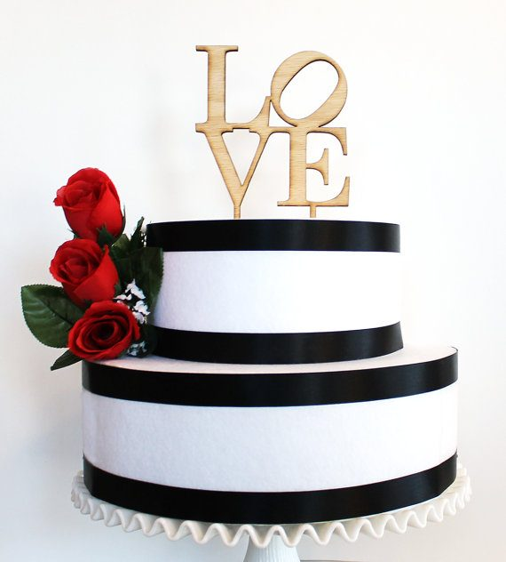 LOVE wood wedding cake topper by Tiffzippy | via Wood Themed Wedding Ideas: http://emmalinebride.com/themes/wood-themed-wedding-ideas/