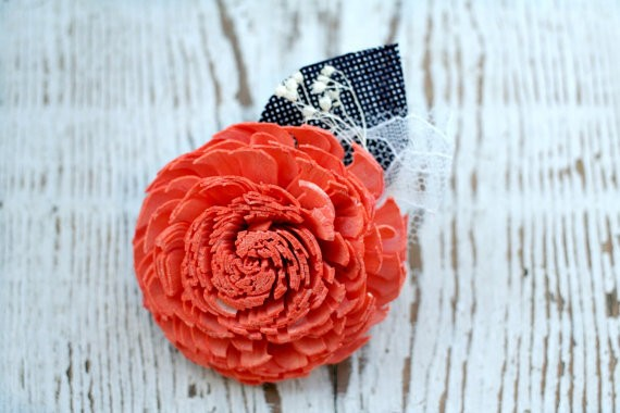 coral orange and navy sola flower boutonniere
