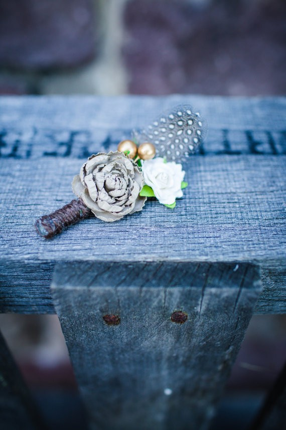 guinea feather boutonniere