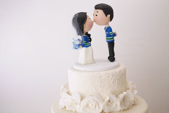 cute kissing couple cake topper vancouver hockey jerseys | figurine cake toppers that look like you | by artifice producciones | https://emmalinebride.com/reception/figurine-cake-toppers/