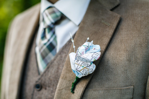 map boutonniere | travel themed wedding ideas: http://emmalinebride.com/themes/travel-theme-wedding-ideas/