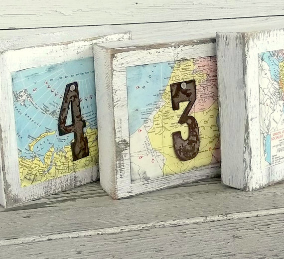 table signs made from maps | travel themed wedding ideas: http://emmalinebride.com/themes/travel-theme-wedding-ideas/