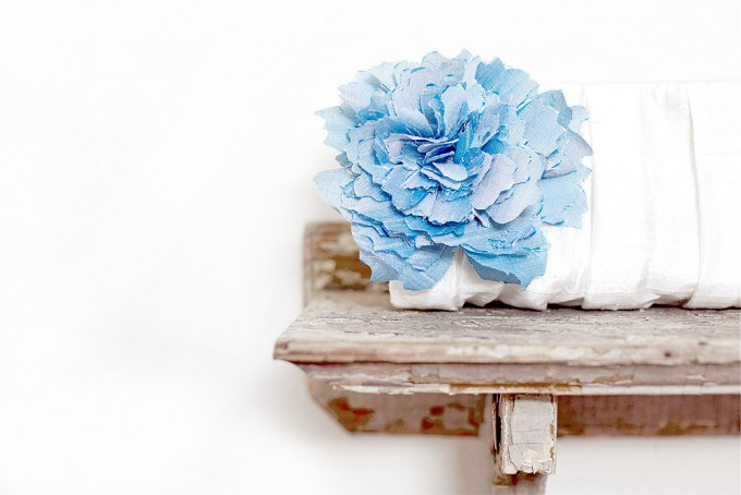 beautiful white clutch with blue flower | bridesmaid clutches instead of flowers via https://emmalinebride.com/bridesmaid/clutches-instead-of-flowers/