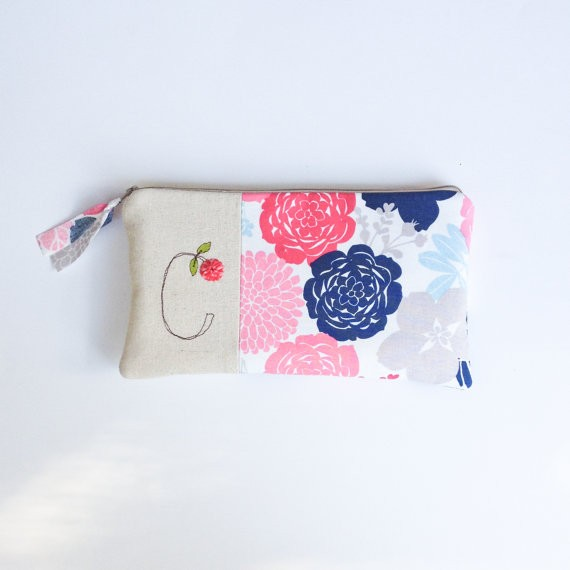 bridesmaid clutch purse with initial and flower print by mamableudesigns | bridesmaid clutches instead of flowers via https://emmalinebride.com/bridesmaid/clutches-instead-of-flowers/