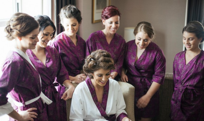 bridesmaids in robes with bride