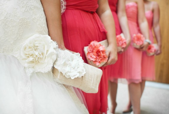 coral pink bridesmaid clutches | bridesmaid clutches instead of flowers via https://emmalinebride.com/bridesmaid/clutches-instead-of-flowers/