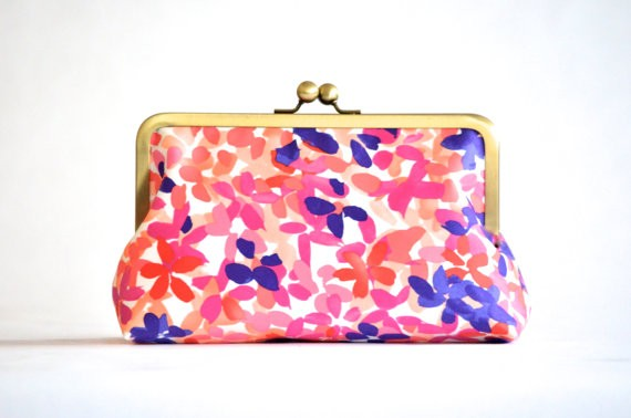 floral orange and purple bridesmaid clutch | bridesmaid clutches instead of flowers via https://emmalinebride.com/bridesmaid/clutches-instead-of-flowers/