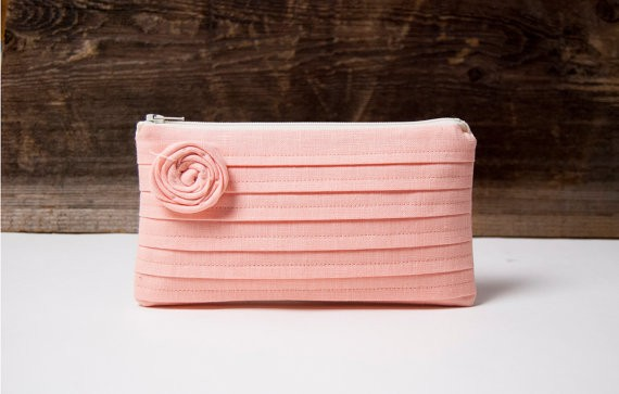 peach pink rosette bridesmaid clutch | bridesmaid clutches instead of flowers via http://emmalinebride.com/bridesmaid/clutches-instead-of-flowers/