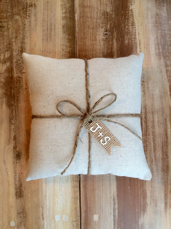 natural cotton ring bearer pillow with burlap tag initials | 41 Beautiful Rustic Ring Pillows on Etsy | https://emmalinebride.com/rustic/ring-pillows-etsy-weddings/