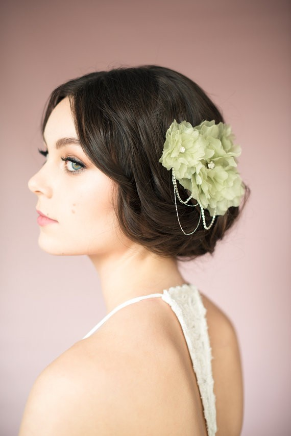 sage green bridal hair accessory | via Sage Wedding Ideas from http://emmalinebride.com/color/sage-green-wedding-ideas/