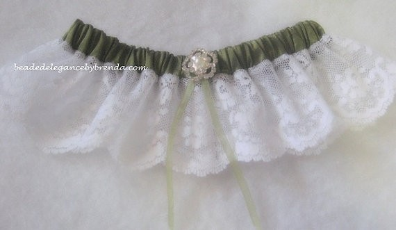 sage green garter | via Sage Wedding Ideas from http://emmalinebride.com/color/sage-green-wedding-ideas/
