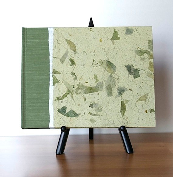 sage green guest book by watermarkbindery | via Sage Wedding Ideas from http://emmalinebride.com/color/sage-green-wedding-ideas/