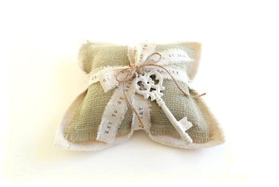 sage wedding ring pillow | via Sage Wedding Ideas from http://emmalinebride.com/color/sage-green-wedding-ideas/