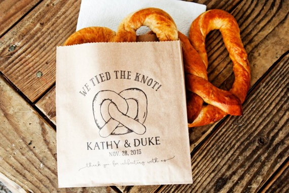 we tied the knot pretzel bags via 26 Things Guests Love at Weddings from A to Z | http://emmalinebride.com/planning/things-guests-love-at-weddings/