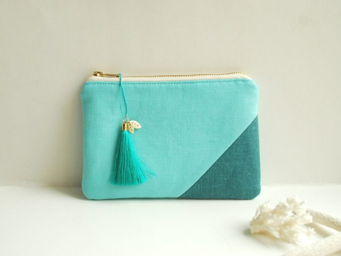 Aqua clutch purse with tassel by Adatele via 21 Festive Tassel Wedding Decorations & Accessories | https://emmalinebride.com/themes/tassel-wedding-decorations/
