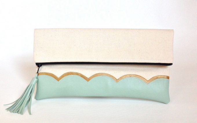 Mint clutch purse with tassel by This Loves That via 21 Festive Tassel Wedding Decorations & Accessories | https://emmalinebride.com/themes/tassel-wedding-decorations/