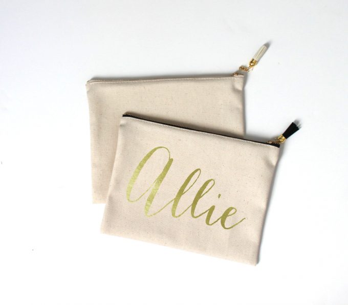 Makeup Bag with Tassel for Bridesmaids Gifts by Aspen Lane Colorado via 21 Festive Tassel Wedding Decorations & Accessories | https://emmalinebride.com/themes/tassel-wedding-decorations/
