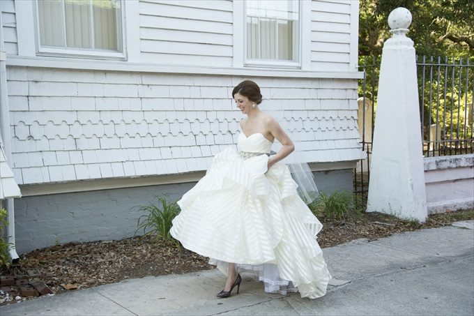 bride walking into church in this Crystal Coast Wedding | North Carolina wedding photographed by Ellen LeRoy Photography - http://emmalinebride.com/real-weddings/breathtaking-crystal-coast-wedding-mara-will-married/