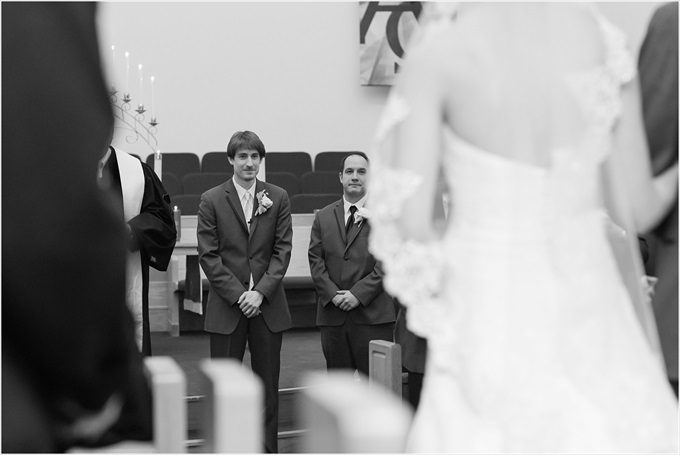 groom watches this bride walk down the aisle in this Sedgefield Country Club wedding| Greensboro, North Carolina winter wedding photographed by Michelle Robinson Photography - http://emmalinebride.com/real-weddings/sedgefield-country-club-wedding/
