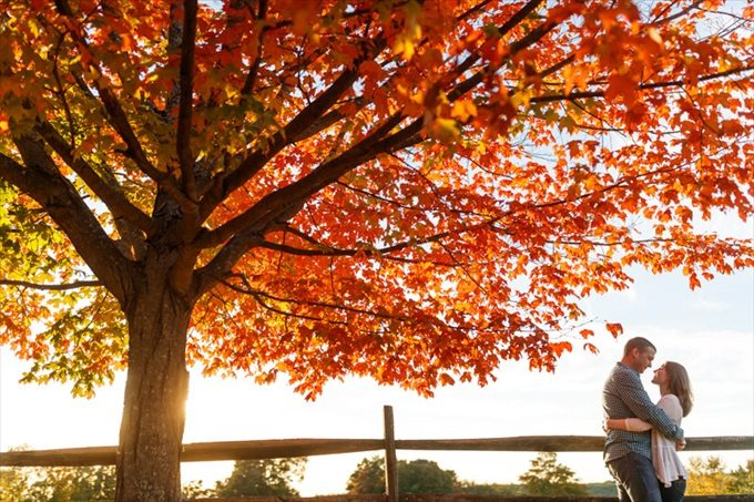 couple hugs under fall leaves| engagement photography by Butler Photography LLC.| Love Fall Weddings? See this Somers, CT Engagement Session - http://emmalinebride.com/real-weddings/love-the-fall-weddings-see-this-somers-ct-engagement-session/