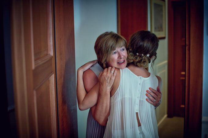 bride hugs mother in destination wedding by Venice, Italy Wedding Planner - Venice Events| An Intimate + Beautiful Venice Wedding at Palazzo Cavalli - http://emmalinebride.com/real-weddings/beautiful-venice-wedding-at-palazzo-cavalli/