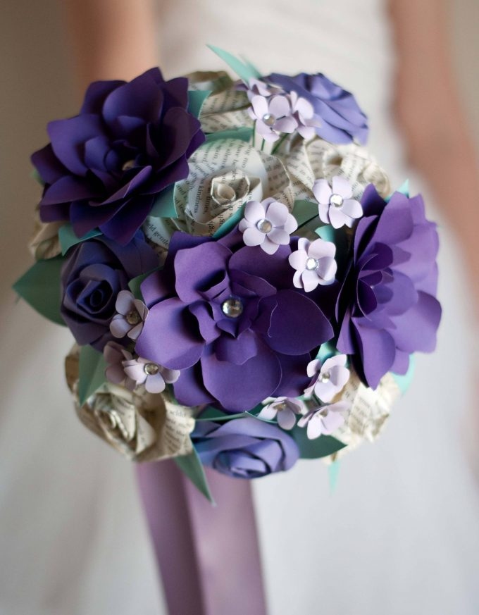 Let's kick off the showcase with this purple flower bouquet made of paper roses, purple hand-cut flowers with rhinestone centers, small white paper flowers, ...
