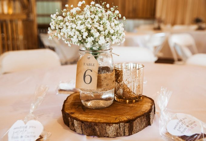 mason jar rustic wood slice centerpiece with table numbers