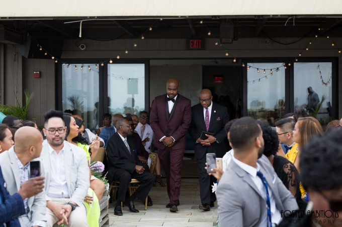 groom walking down the aisle with the officiant  - le club avenue wedding