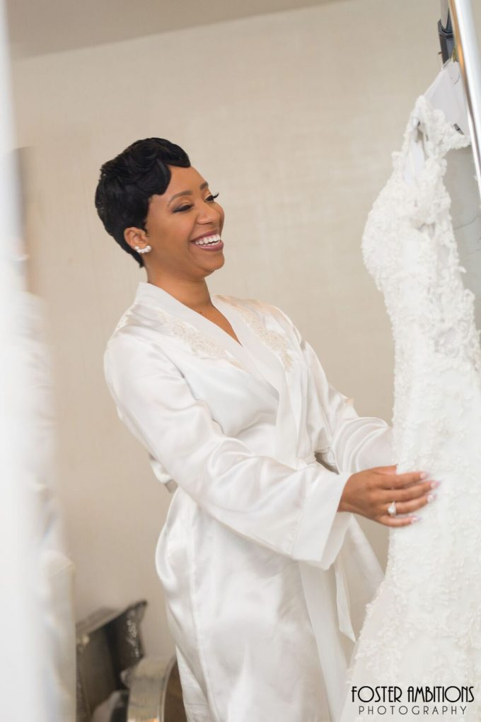 the bride smiling as she sees her dress - le club avenue wedding