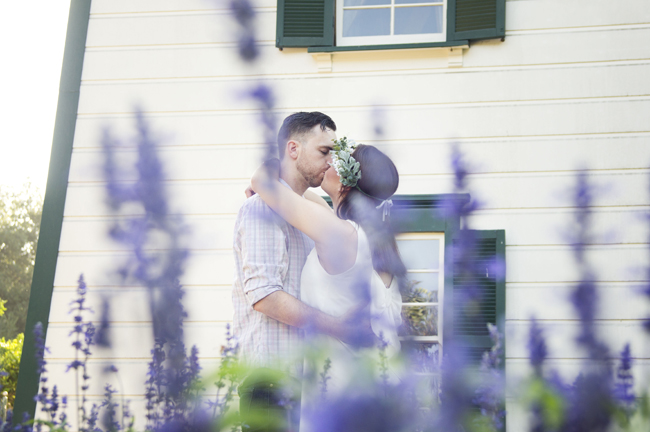engagement session kiss by flowers in Santa Fe Springs