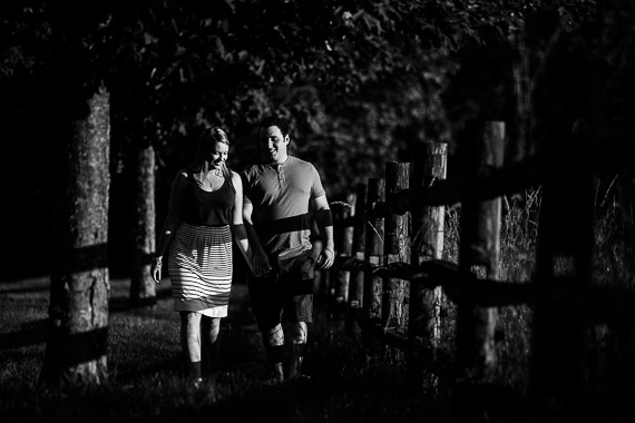 Annie & Josh's Engagement - couple walking in field